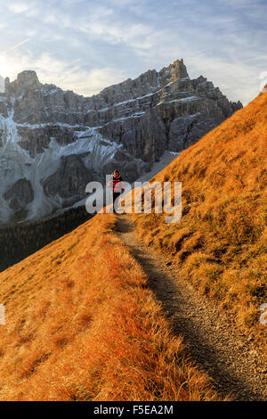 Hiker on a trail around the Forcella De Furcia at sunrise, Val di Funes, South Tyrol, Dolomites, Italy, Europe - Stock Photo