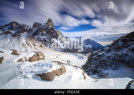 Cloudy winter sky on the snowy peaks of the Pale di San Martino, Rolle Pass, Panaveggio, Dolomites, Trentino-Alto - Stock Photo