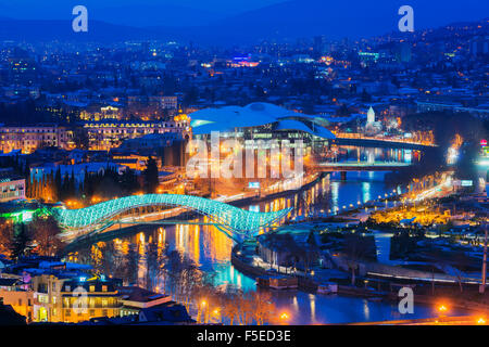 City view, Bridge of Peace and Public Service Hall House of Justice on Mtkvari River, Tbilisi, Georgia, Caucasus, - Stock Photo