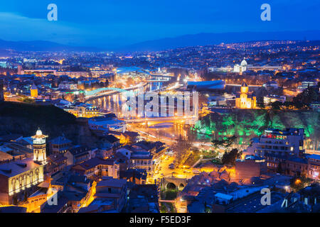 City view including Bridge of Peace and Public Service Hall House of Justice on Mtkvari River, Tbilisi, Georgia, - Stock Photo