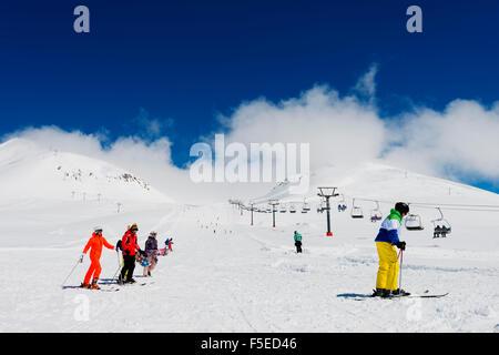 Skiers at Gudauri ski resort, Georgia, Caucasus region, Central Asia, Asia - Stock Photo
