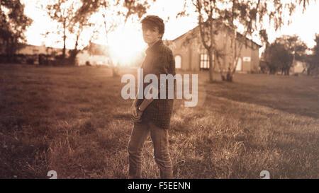 Teenage boy looking gloomy - Stock Photo