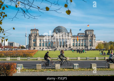 German Reichstag building and dome, with tourists in foreground, Berlin, Germany, Europe - Stock Photo