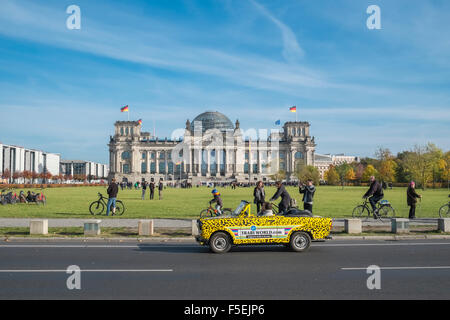Tourists in Trabi car stopping to view the Reichstag building, Berlin, Germany, Europe - Stock Photo