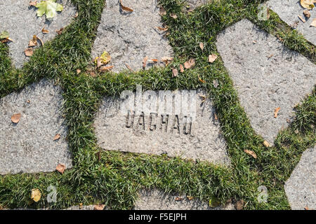 Stone with Dachau name at Memorial to Murdered Sinti and Roma People, Mitte, Berlin, Germany - Stock Photo