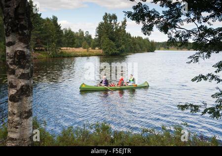 Family in canoe, Varmland, Sweden - Stock Photo