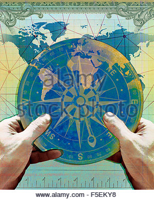 Hands holding navigation compass over chart of world map - Stock Photo