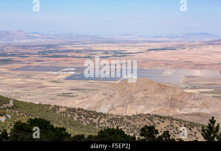 Aerial view of solar panels in a large solar farm array in the countryside in Southern Spain - Stock Photo
