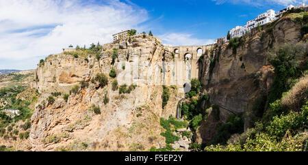 Puente Nuevo bridge and old town building over El Tajo gorge at Ronda, Andalucia, Spain - Stock Photo