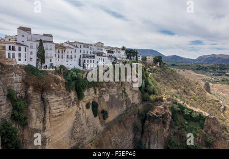 Old town buildings cling to rock face over El Tajo gorge at Ronda, Andalucia, Spain - Stock Photo