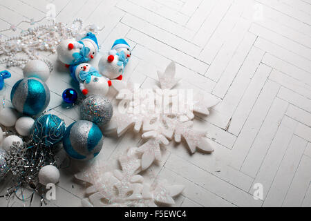 Winter cozy christmas background - decorative wooden snowflakes on a white wooden background shabby chic style - Stock Photo