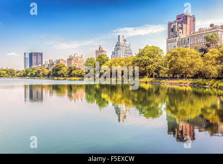 Central Park reflected in lake, New York City, USA. - Stock Photo