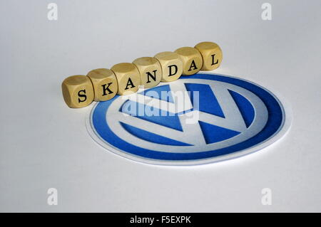 ILLUSTRATION - Cube letters that form the word 'scandal' next to the Volkswagen logo. The photo was taken on 15 - Stock Photo