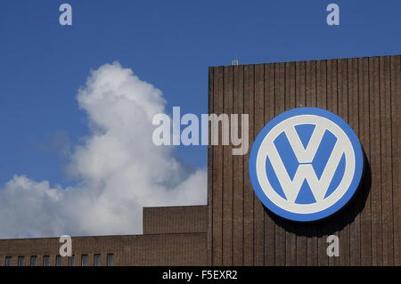 A Volkswagen Logo on the facade of the Volkswagen factory in Wolfsburg, Germany, 30 September 2015. Photo: S. Steinach - Stock Photo