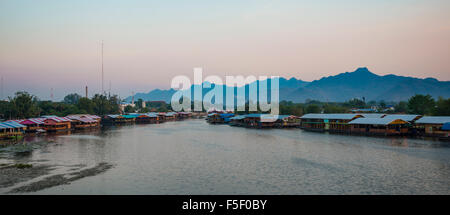 Floating houses at dusk, River Kwai, Kanchanaburi Province, Central Thailand, Thailand - Stock Photo