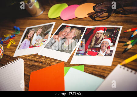 Composite image of high angle view of office supplies and blank instant photos - Stock Photo