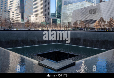 9/11 Memorial North Pool at the site of the World Trade Centre Towers, New York USA on a cold winter day - Stock Photo