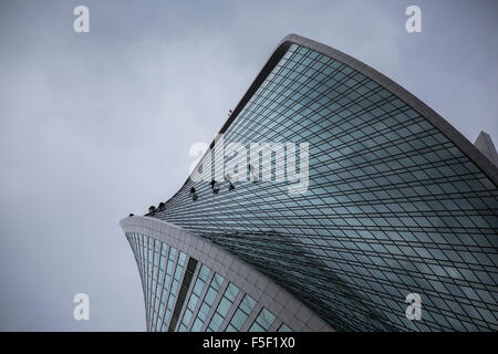 Window Cleaners Working on the DNA Building in Moscow City - Stock Photo