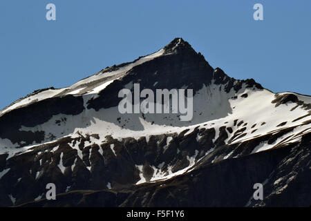 Summer snow coverage of Mount Aspiring, South Island, New Zealand - Stock Photo