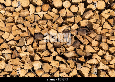 A stack of chopped firewood in Austria ready for the winter. - Stock Photo