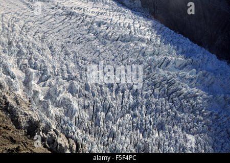 Franz Josef Glacier, a glacier melting due to climate change, Franz Josef, South Island, New Zealand - Stock Photo