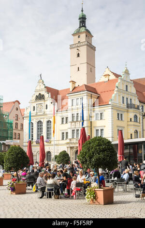INGOLSTADT, GERMANY - OKTOBER 3: Tourists in a cafe in front of the historic town hall of Ingolstadt, Germany on - Stock Photo