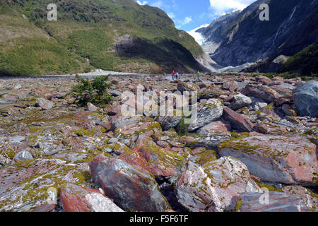 Rocks at Franz Josef Glacier, a glacier melting due to climate change, Franz Josef, South Island, New Zealand - Stock Photo