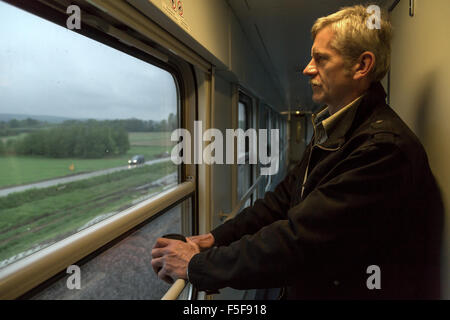 Tarnów, Poland, a passenger in a long-distance train - Stock Photo