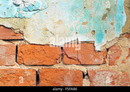 Brick wall with part of plaster - Stock Photo