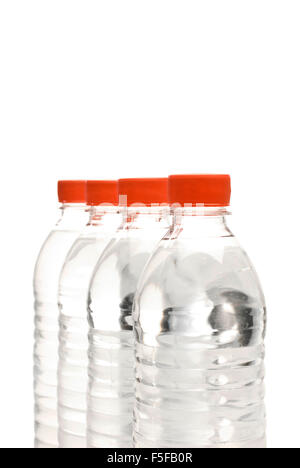 Four Bottles of Water on a white background. - Stock Photo