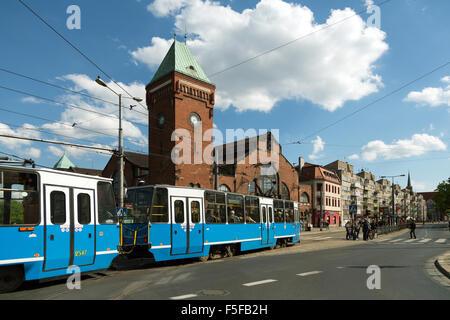 Wroclaw, Poland, tram in front of the Market Hall (Hala Targowa) - Stock Photo