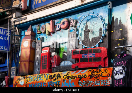 London icons Big Ben London Eye Tower Bridge Guards police taxis red buses etc on shop front Camden London England - Stock Photo