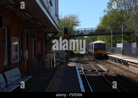 Looking along the platform towards Reading with WMl2 in view and 66 train coming through the station and a goods - Stock Photo