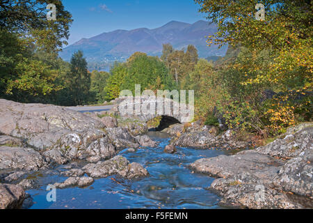 Ashness Bridge in autumn  and views across Catbells and Maiden Moor, Lake District, Cumbria, England, Uk, Gb.