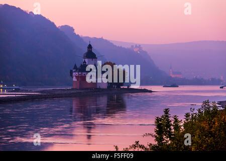 Burg Pfalzgrafenstein castle, Upper middle Rhine valley, Germany, near Kaub, at dusk, in the back city of Oberwesel - Stock Photo