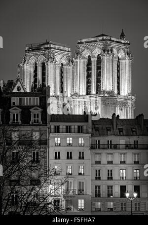 French Gothic towers of Notre Dame de Paris Cathedral illuminated at night. Ile de la Cite, 4th arrondissement, - Stock Photo