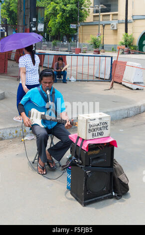 MANILA, PHILIPPINES - JUNE 7, 2015: Unknown blind guitar player in the streets of Manila. In 2012, 27.9 percent - Stock Photo