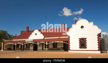 Panoramic view of historic ornate red & white railway station building against blue sky at outback town of Quorn, South Australia