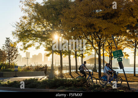 New York, NY People riding CitiBikes on the Hudson River Park Greenway in Autumn ©Stacy Walsh Rosenstock/Alamy - Stock Photo