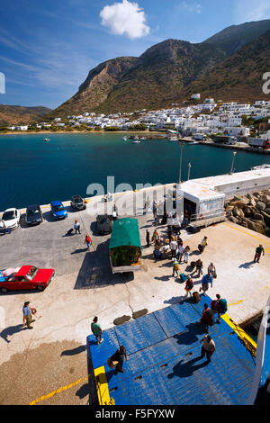 Lorry and passengers getting aboard a ferry in the port of Kamares village in Sifnos island, Greece - Stock Photo