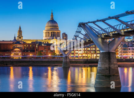 St Pauls cathedral millennium bridge and City of London skyline at night River Thames City of London UK GB EU Europe - Stock Photo