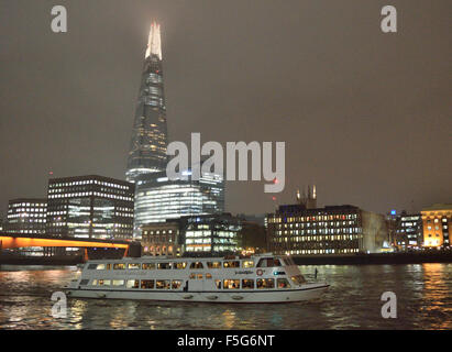 Party boat 'Silver Barracuda' heading up the river Thames on a nighttime cruise through London - Stock Photo