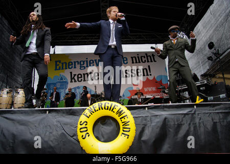 Frank A. Delle (Eased), Pierre Baigorry (Peter Fox), Demba Nabe - Auftritt der Band 'Seeed' - Demonstration 'Energiewende - Stock Photo