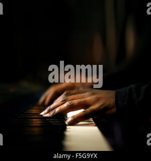 Hands of pianist playing synthesizer close-up - Stock Photo