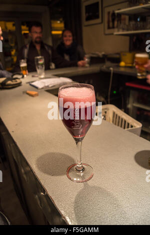 A printed glass of Liefmans Kriek craft beer on a zinc bar, Bar du Midi, Amiens, Somme, Picardie, France pub table - Stock Photo
