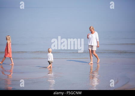 Sweden, Gotland, Faro, Skar, Mother with son (2-3) and daughter (8-9) walking in shoals - Stock Photo
