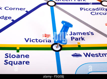 LONDON, UK - NOVEMBER 1ST 2015: A map pin marking the location of Victoria station on a London Underground Map, - Stock Photo