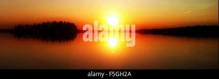 A beautiful sunset photo over lake,dreamy state. - Stock Photo