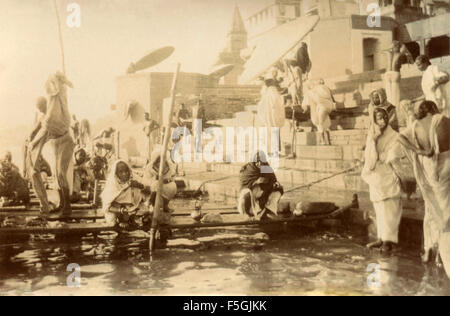 Religious ceremonies along the sacred river in Benares , India - Stock Photo