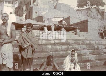 Religious ceremonies along the sacred river in Benares , India - Stock Photo